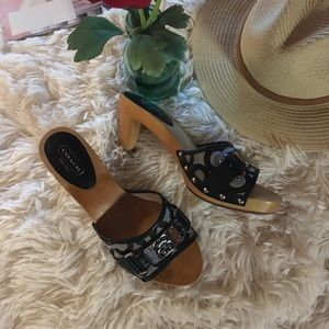 COACH - blk/slip on sandals with coach across toe.
